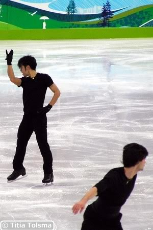 background Daisuke Takahashi, foreground Stephane Lambiel